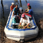 Project team members navigate the Macai River using a zodiac boat to get from one nesting area to another.