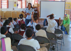 Celeshia Guy teaching local kids about parrot conservation.