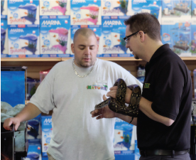 Part of Jesse's job is to educate hobbyists and pet shop staff about the proper and responsible care of herps.